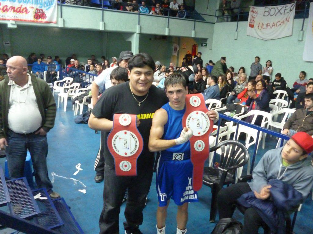 Calderón y Quiroga con sus cinturones.